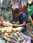 Diego works on bracelets for The PEACH Pit at his shop in Antigua, Guatemala.