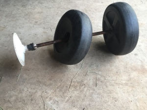 broken lawn cart wheel and axle.