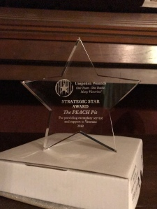 "Acrylic star with ""Strategic Star Award"" and ""The PEACH Pit"" etched in it."